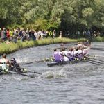 team rowing on the river cam
